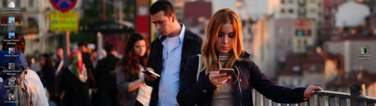 dna header - young man and woman in town looking down at smartphone