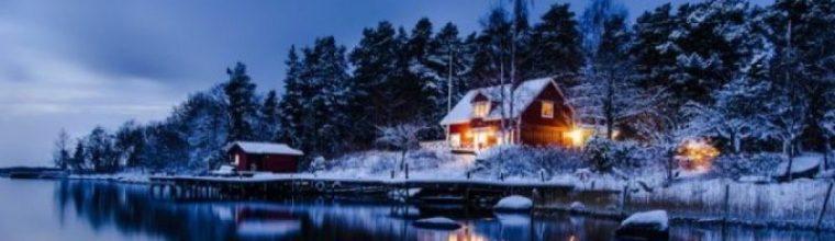 cropped-beleuchtetes-winterhaus-am-see-im-frost.jpg